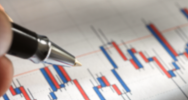 Pen pointing to a research graph